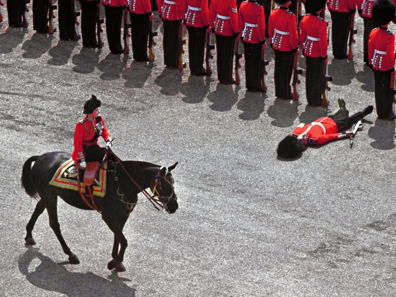 A foot guard passes out during the trooping the colour in June, 1970